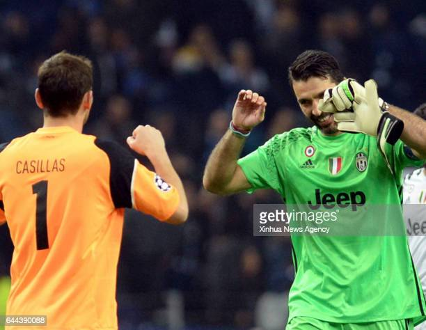 Porto's goalkeeper Iker Casillas greets Juventus's goalkeeper Gianluigi Buffon after the first leg match Round of 16 of the UEFA Champions League...