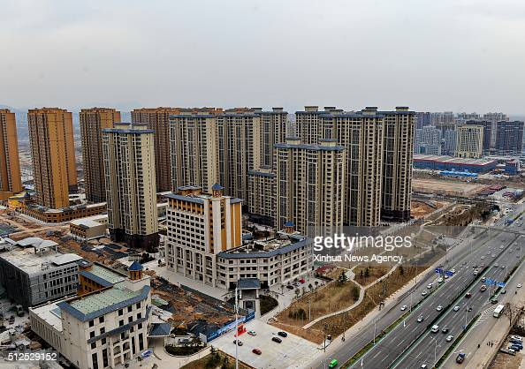 SHIJIAZHUANG Feb 26 2016 Photo taken on Feb 18 2016 shows a cluster of residential buildings for sale in Shijiazhuang capital of north China's Hebei...