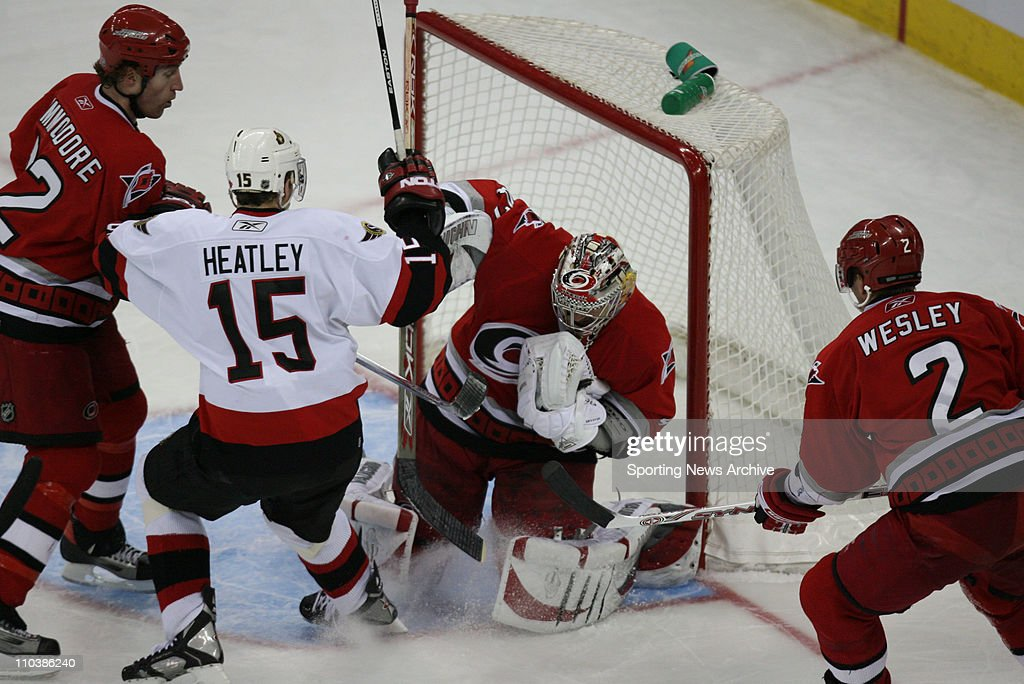 Feb 27, 2007 - Raleigh, NC, USA - Ottawa Senators DANY HEATLEY against Carolina Hurricanes JOHN GRAHAME , MIKE COMMODORE on Feb. 27, 2007, at the RBC Center in Raleigh, NC. The Senators won 4-2.