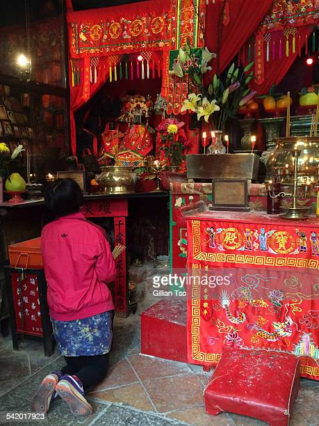 Feb 27 2015 Woman praying at the Hung Shing Temple Wanchai Hong Kong It is customary on the 2nd day of the Lunar New Year to visit a temple to have...