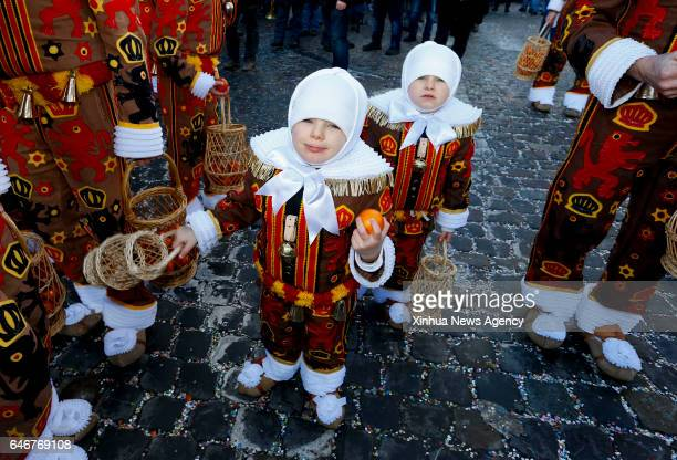 Feb 28 2017 Children 'Gilles' march and hold oranges symbolizing the coming Spring in Binche Belgium on Feb 28 2017 Binche's threeday carnival a...