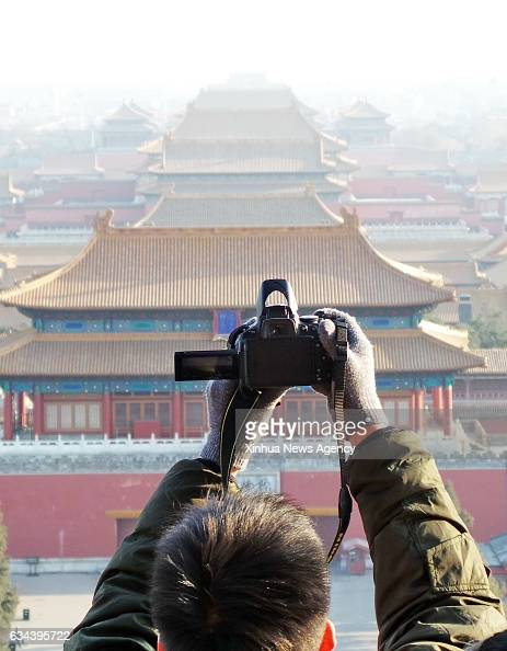 BEIJING Feb 9 2017 A man takes photos of the Palace Museum at Jingshan Park in Beijing capital of China Feb 8 2017 Beijing has strengthened the...