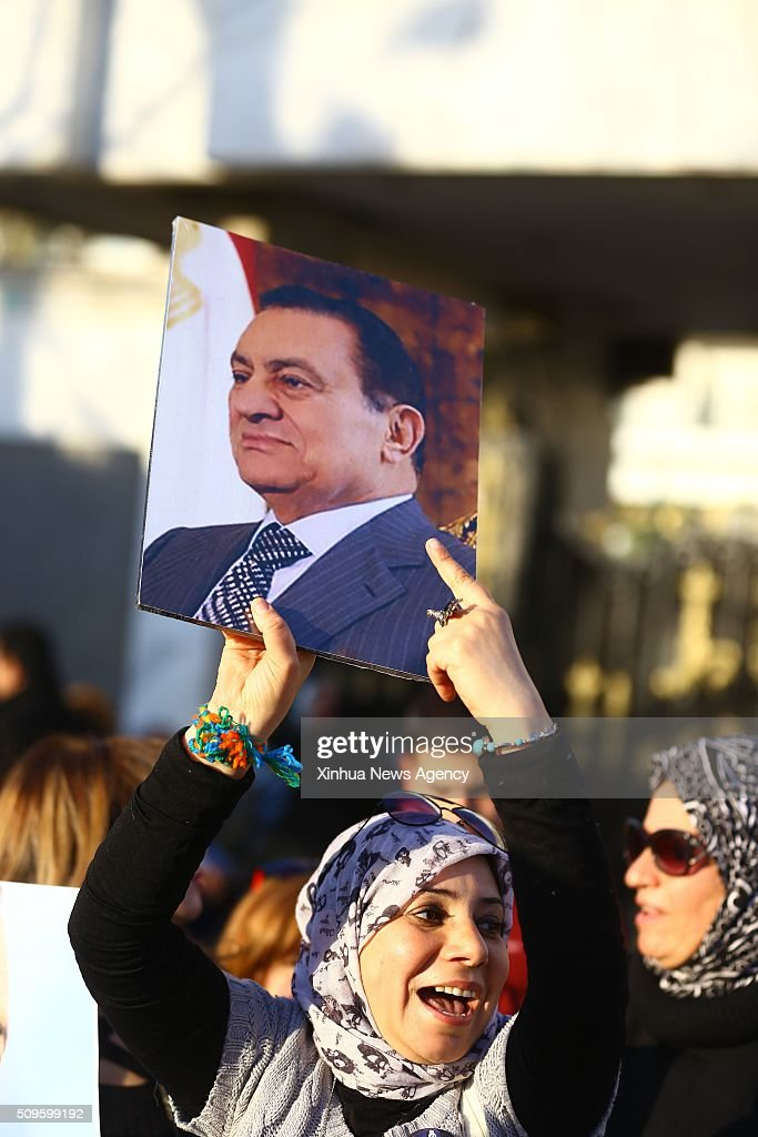 CAIRO, Feb.11, 2016 -- A supporter of Egypt's former President Hosni Mubarak holds a poster during a protest marking the 5th anniversary of Mubarak's resignation outside Maadi Armed Forces Hospital in Cairo, Egypt on Feb.11,2016.