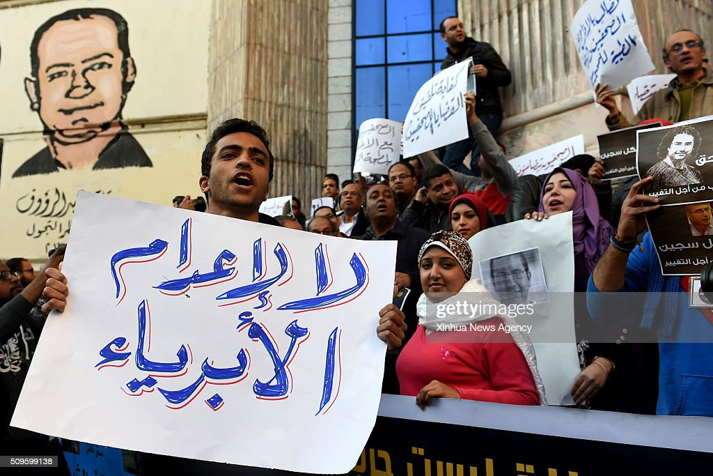 CAIRO, Feb.11, 2016-- Protesters hold posters during a protest demanding the release of journalists arrested by police in front of the Syndicate of Journalists in Cairo, Egypt on Feb. 11, 2016.