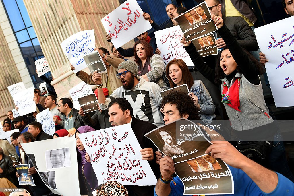 CAIRO, Feb.11, 2016 -- Protesters hold posters during a protest demanding the release of journalists arrested by police in front of the Syndicate of Journalists in Cairo, Egypt on Feb. 11, 2016.