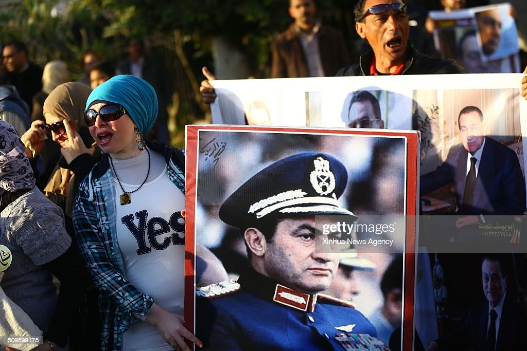 CAIRO, Feb.11, 2016 -- Supporters of Egypt's former President Hosni Mubarak hold posters during a protest marking the 5th anniversary of Mubarak's resignation outside Maadi Armed Forces Hospital in Cairo, Egypt on Feb.11,2016.