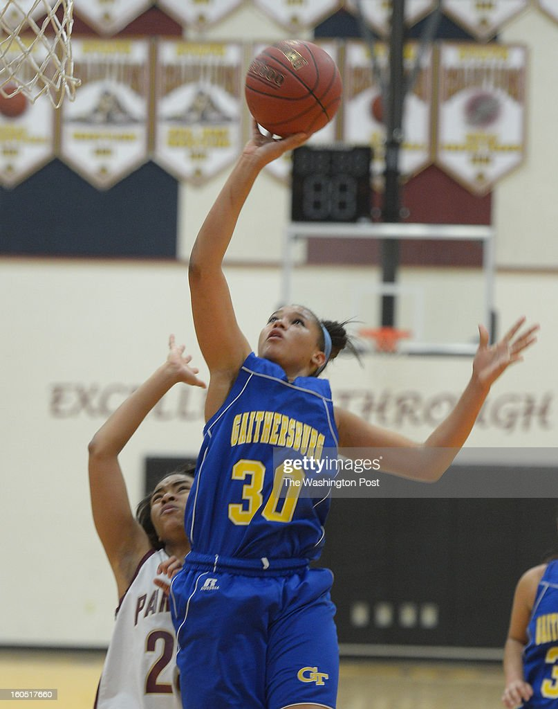 Gaithersburg F Janessa Fauntroy (30) drives to the basket during 2nd half action against Paint Branch on February 1, 2013 in Burtonsville, MD