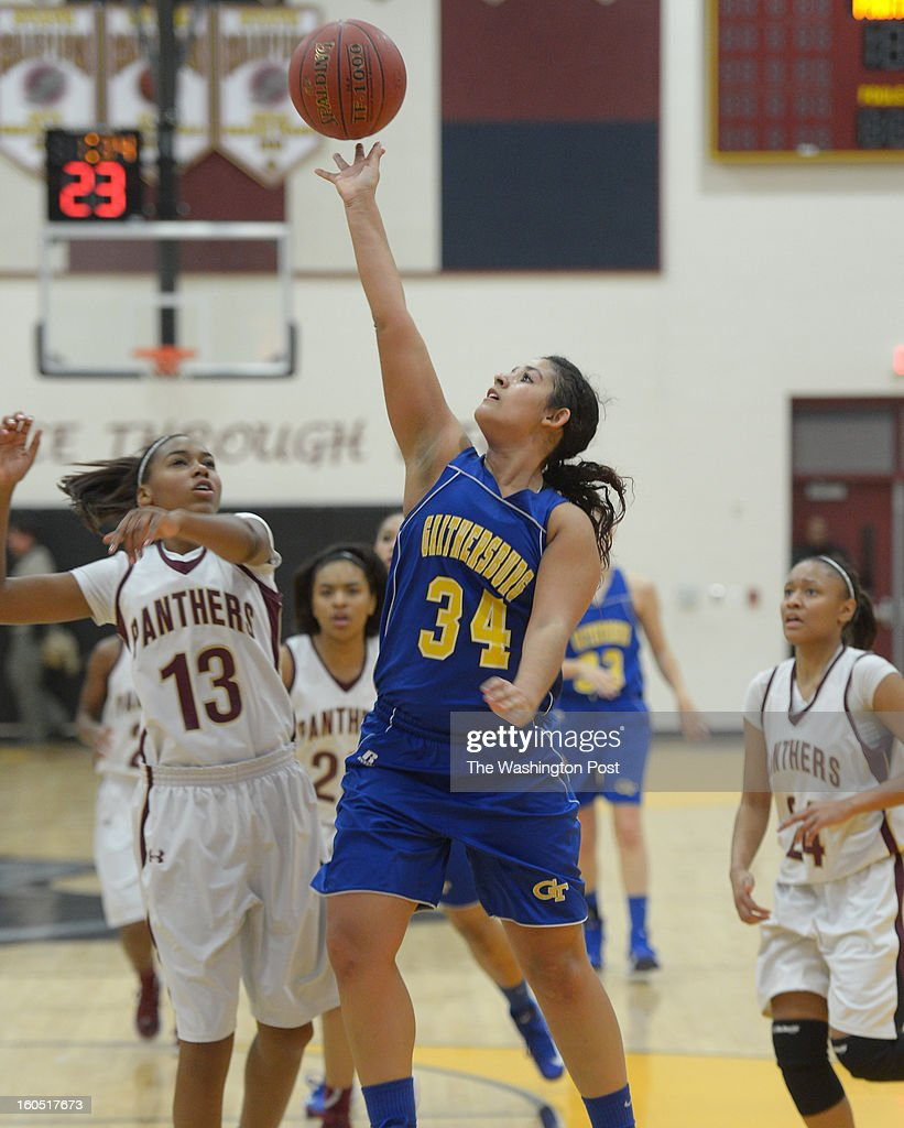 Gaithersburg G Christine Mabry (34) drives to the basket during 2nd half action against Paint Branch on February 1, 2013 in Burtonsville, MD