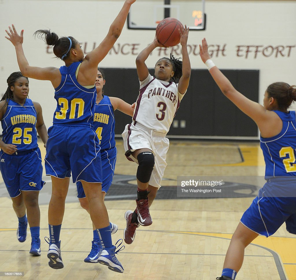Paint Branch G Daisa Harris (3) draws the attention of four Gaithersburg defenders as she drives to the basket during 1st half action on February 1, 2013 in Burtonsville, MD