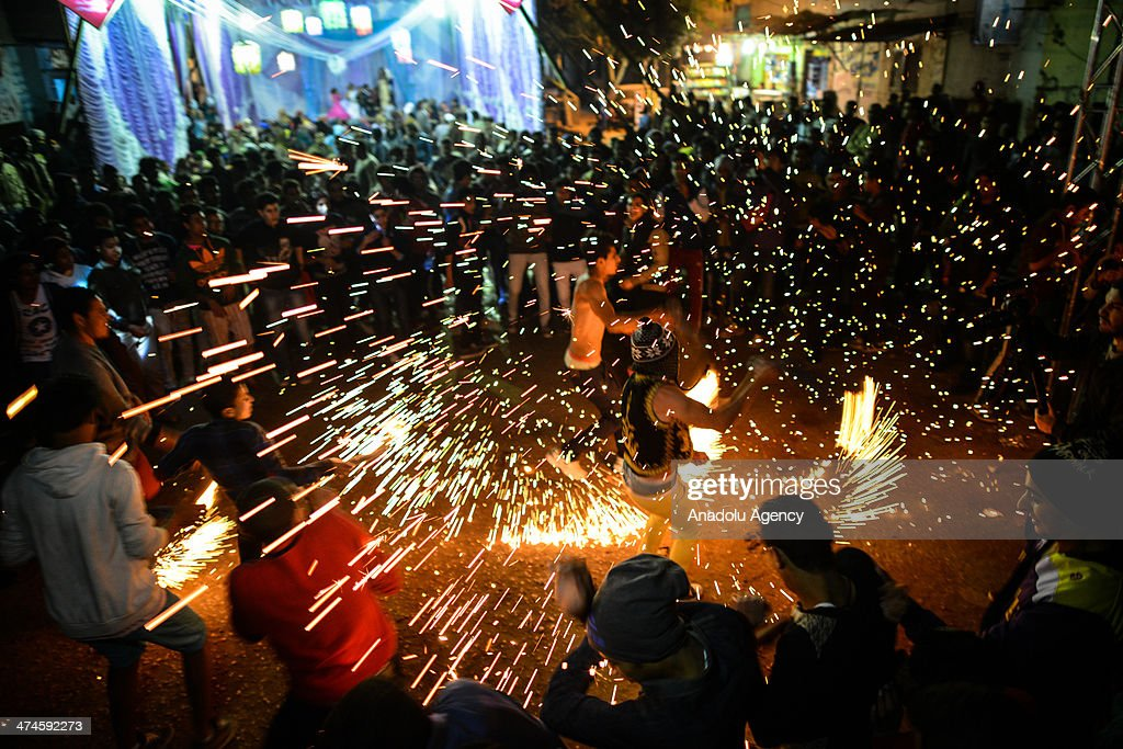 February 10,2014 dated picture shows Egyptians in Dar El Salaam district of Cairo holding a wedding in way a festival is held. The event called 'Mahargan' turns to be a ticket-free street art of a kind together with the laser lights, torches and confetti rain as the participants' and guests' dance accompanied by rap.