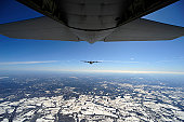 February 11, 2011 - Two EC-130J Commando Solo aircraft fly in formation during a training sortie above Harrisburg, Pennsylvania.