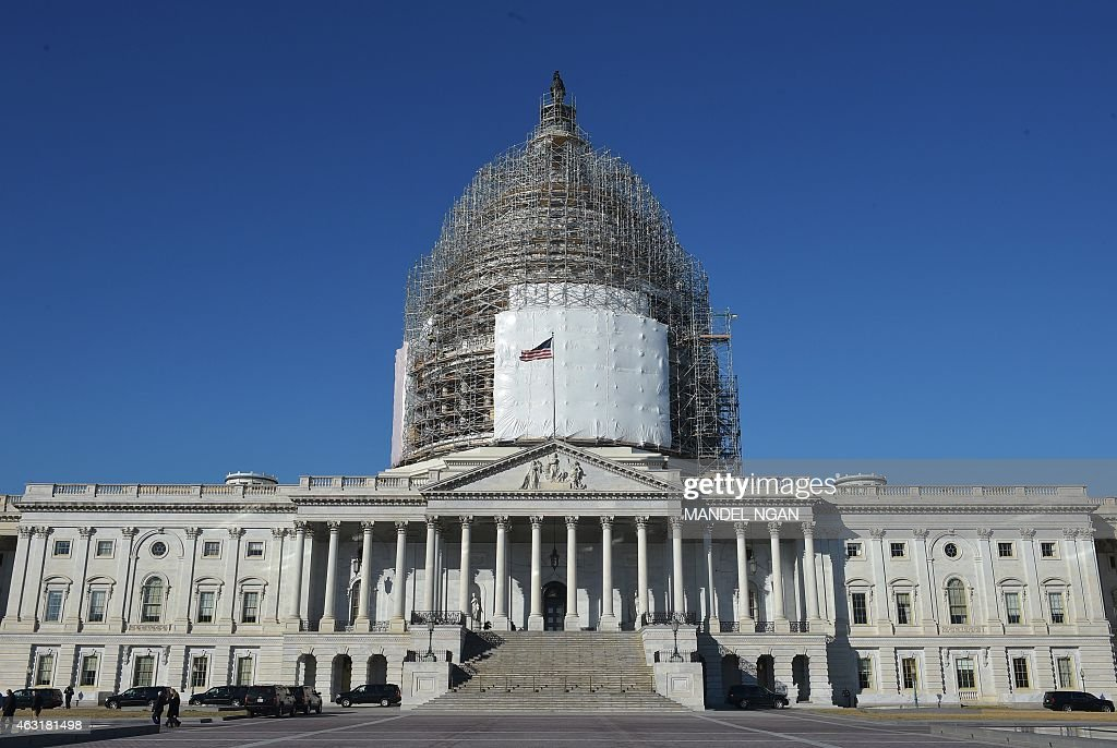 A February 11 2015 photo shows the US Capitol with its dome encased in scaffolding as it undergoes renovation in Washington DC The White House...