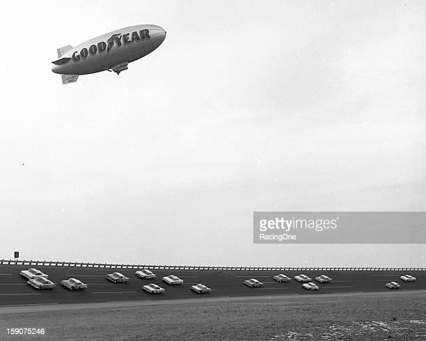 The Goodyear Blimp hovers over the field as they race during the second 100mile qualifier for the Daytona 500 NASCAR Cup race at Daytona...