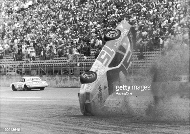 Ricky Rudd's Ford Thunderbird starts to turn over after he was bumped by Jody Ridley during the Busch Clash NASCAR Cup race at Daytona International...