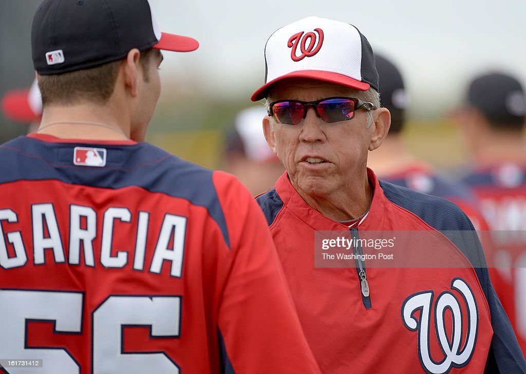 Washington Nationals manager Davey Johnson (5) talks with relief pitcher Christian Garcia (56) during spring training workouts on February 14, 2013 in Viera, FL