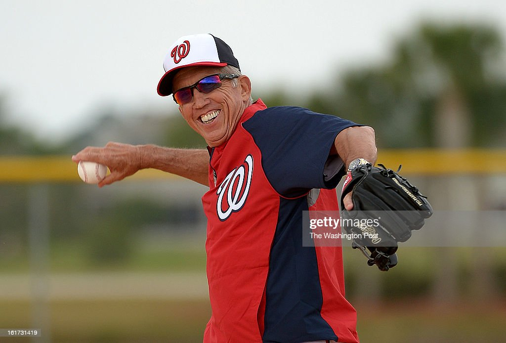 Washington Nationals manager Davey Johnson (5) was all smiles as he loosens up his arm at the start of spring training workouts on February 14, 2013 in Viera, FL