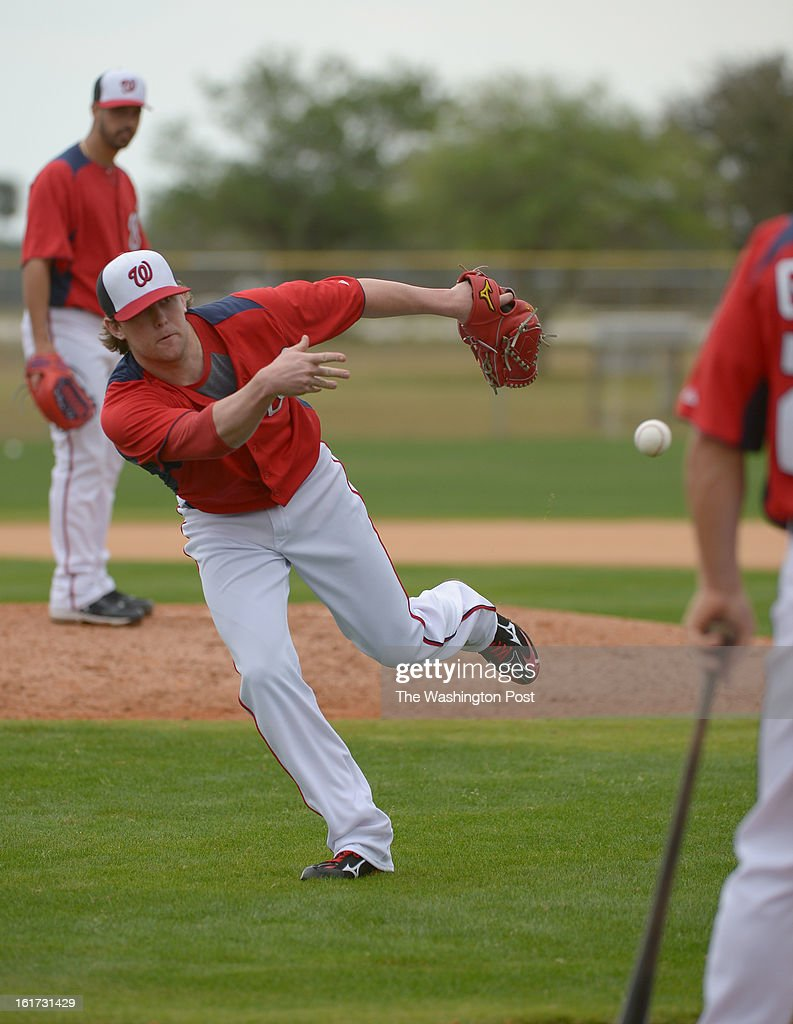 Washington Nationals relief pitcher Drew Storen (22) fields the ball during spring training workouts on February 14, 2013 in Viera, FL