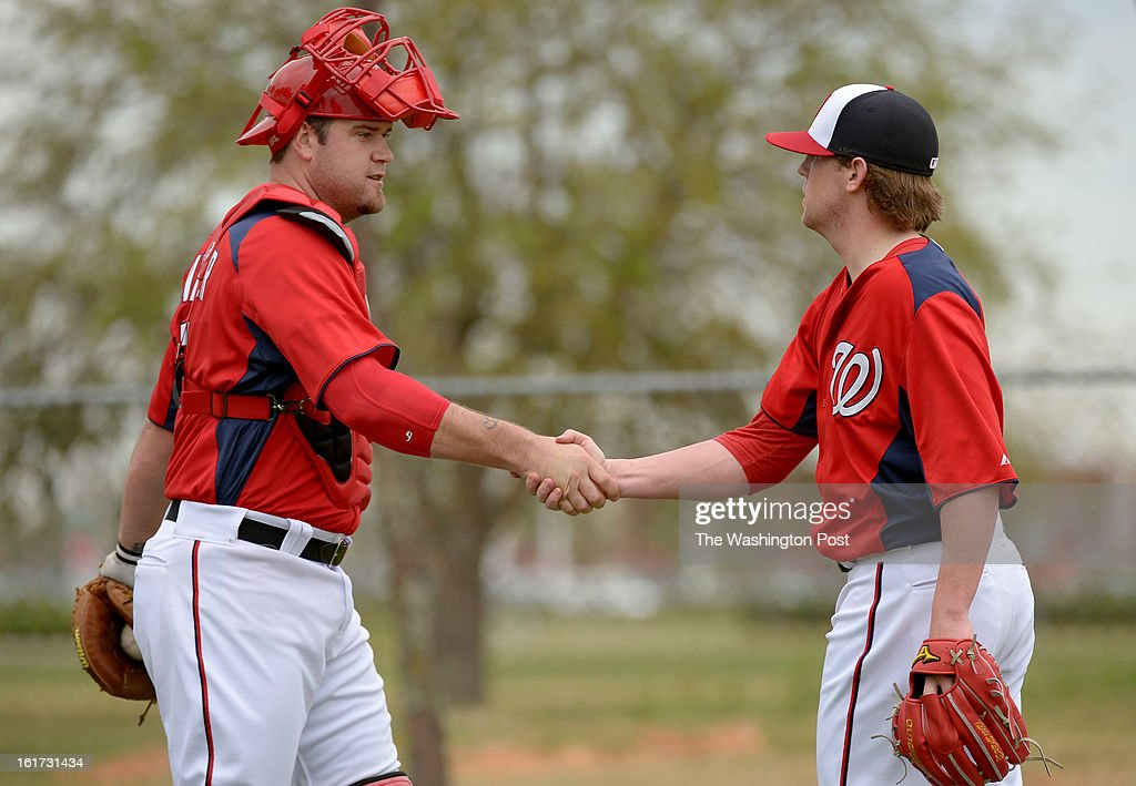 Washington Nationals relief pitcher Drew Storen (22) thanks C Chris Snyder (7) after their bullpen session during spring training workouts on February 14, 2013 in Viera, FL