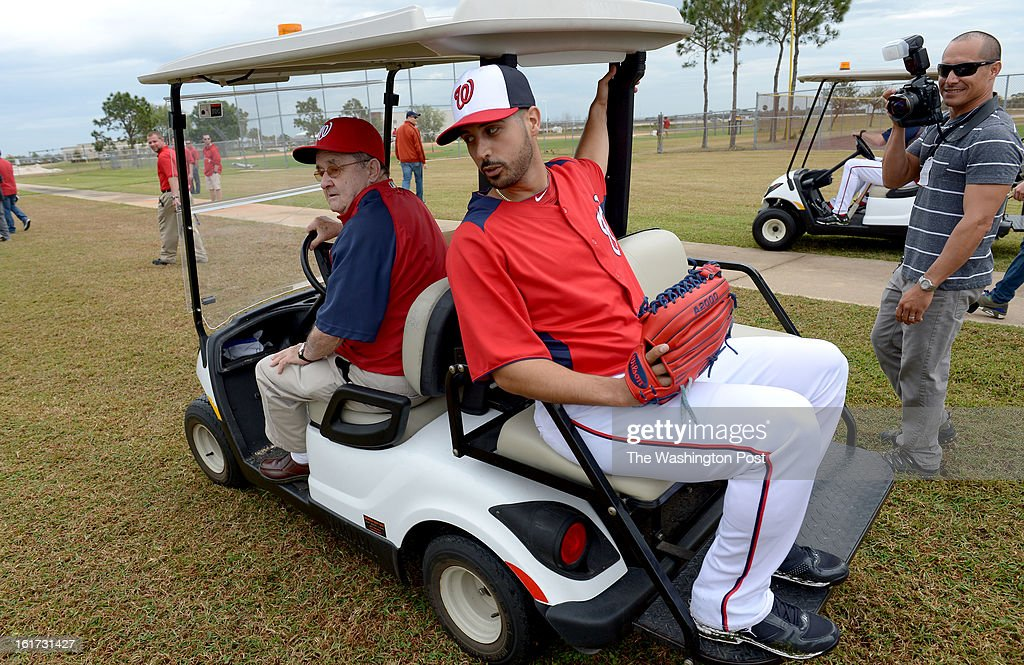 Washington Nationals starting pitcher Gio Gonzalez (47) gets a lift to his bullpen session by Dave McConnell of the spring training security detail during spring training workouts on February 14, 2013 in Viera, FL