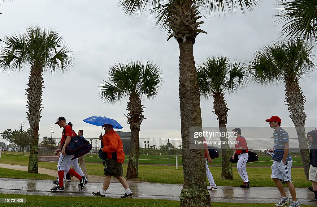 Washington Nationals starting pitcher Stephen Strasburg (37) (L) leaves the training complex after their first spring training workout was cut short by rain on February 14, 2013 in Viera, FL