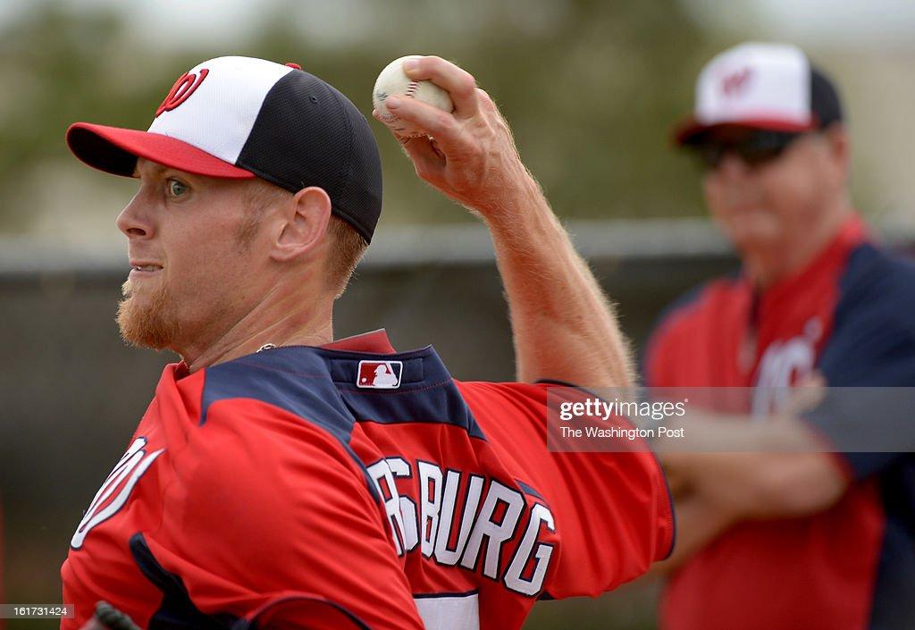 Washington Nationals starting pitcher Stephen Strasburg (37) throws a bullpen session under the watchful eye of pitching coach Steve McCatty during spring training workouts on February 14, 2013 in Viera, FL