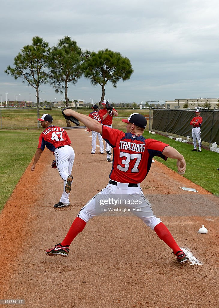 Washington Nationals starting pitchers Stephen Strasburg (37) and Gio Gonzalez (47) throw their first bullpen session during spring training workouts on February 14, 2013 in Viera, FL