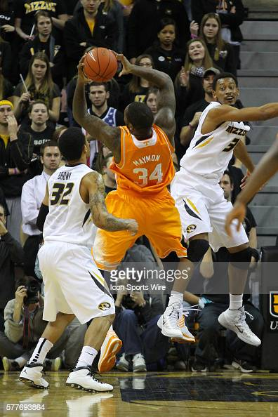 Tennessee Volunteers forward Jeronne Maymon grabs a rebound over Missouri Tigers guard Jabari Brown and forward Johnathan Williams III during the...