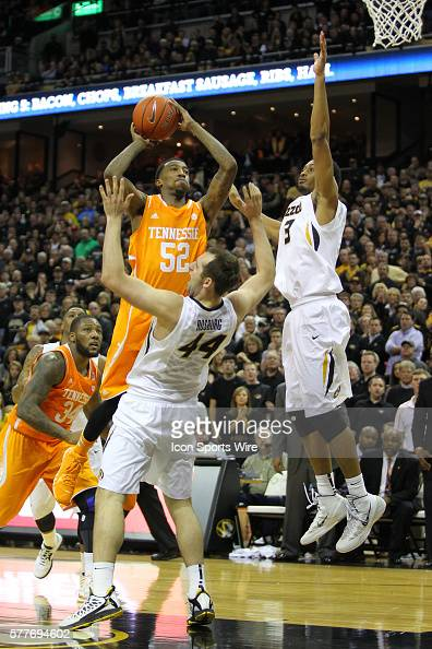Tennessee Volunteers guard Jordan McRae puts the ball up past Missouri Tigers forward Johnathan Williams III while knocking down Missouri Tigers...