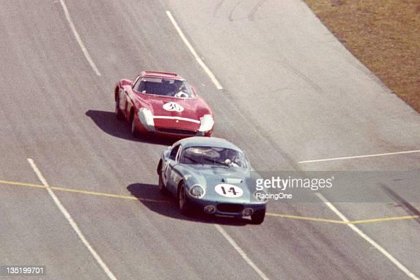 The No 14 Shelby Cobra Daytona Coupe of Bob Holbert Dave MacDonald and Jean Guichet leads the eventual race winning Ferrari 250 GTO of Pedro...