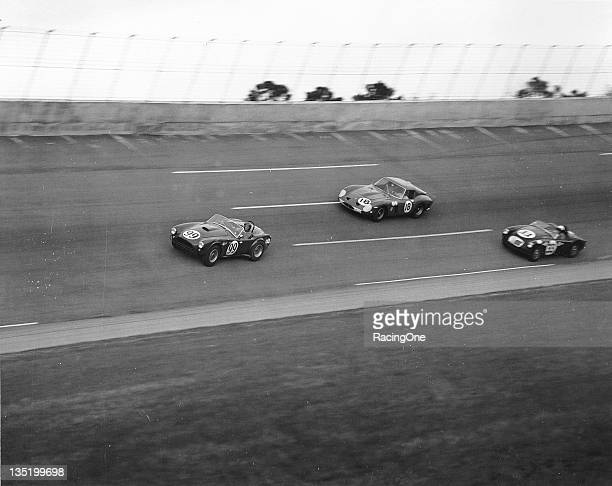 The No 97 Shelby Cobra of Dave MacDonald leads the Ferrari 250 GTO of Pedro Rodriguez and the No 33 MGA of John E Hill on the high banks of Daytona...