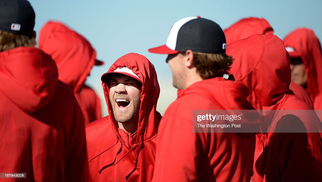 Washington Nationals outielder Bryce Harper (34) cracks up as the players gather for their first full squad spring training workout on February 17, 2013 in Viera, FL