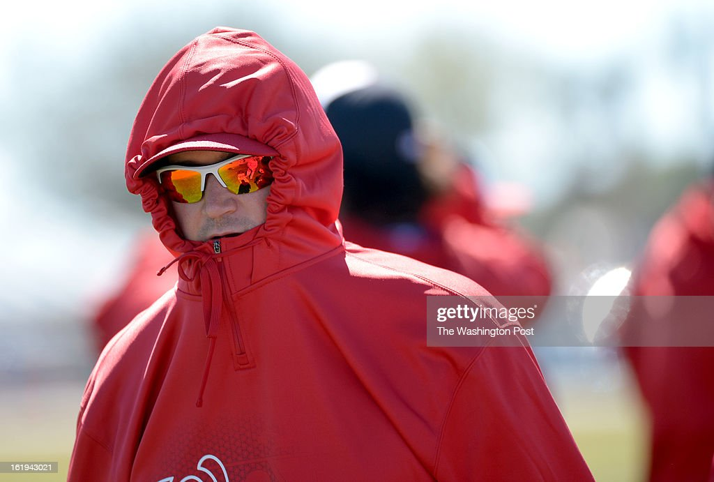 Washington Nationals third baseman Ryan Zimmerman (11) is bundled up during spring training workouts on February 17, 2013 in Viera, FL