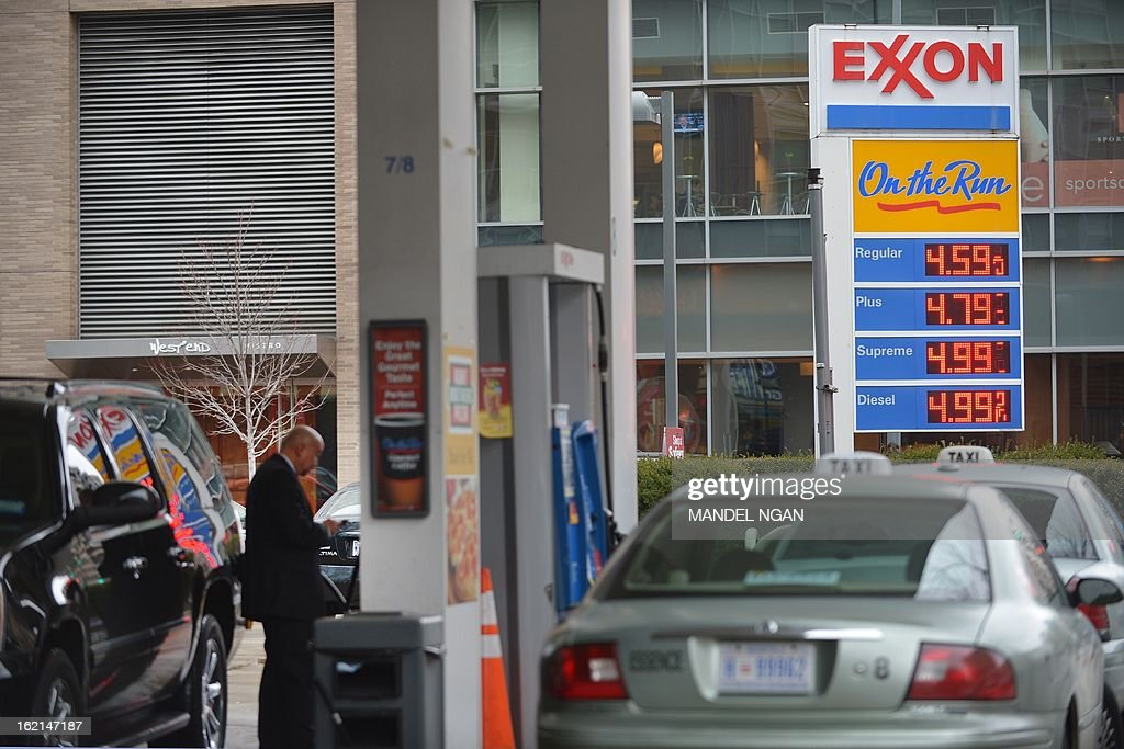 A February 19, 2013 photo shows taxis and cars at a Exxon station in the Foggy Bottom neighbourhood of Washingon, DC. US gas prices at the pumps have risen for over 30 days consecutively to a four-month high. According to the AAA, the national average for a gallon of regular gas is $3.748. AFP PHOTO/Mandel NGAN