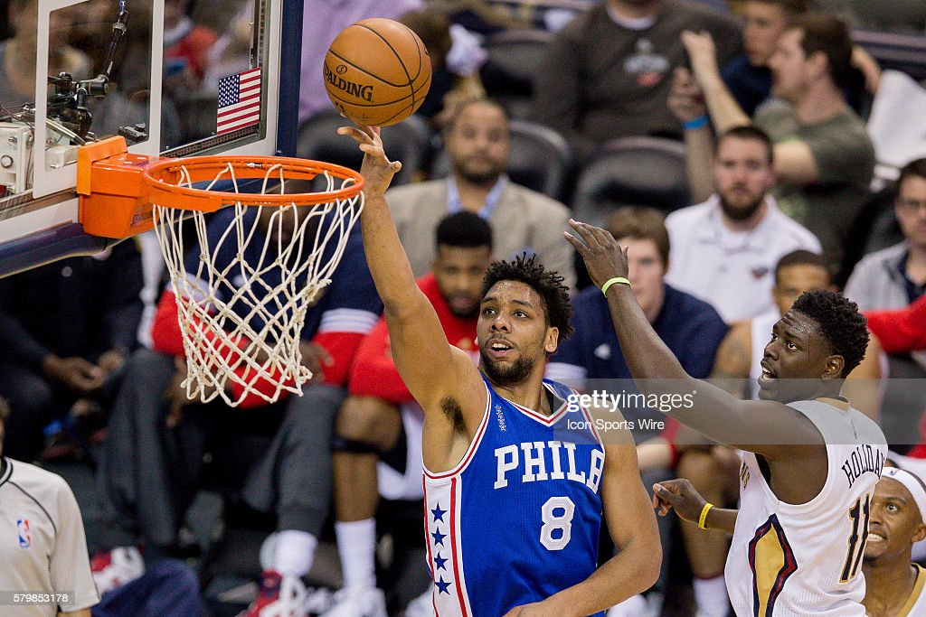 Philadelphia 76ers center Jahlil Okafor (8) drives to the basket against New Orleans Pelicans guard Jrue Holiday (11) during the NBA game between the Philadelphia 76ers and the New Orleans Pelicans at the Smoothie King Center in New Orleans, LA.