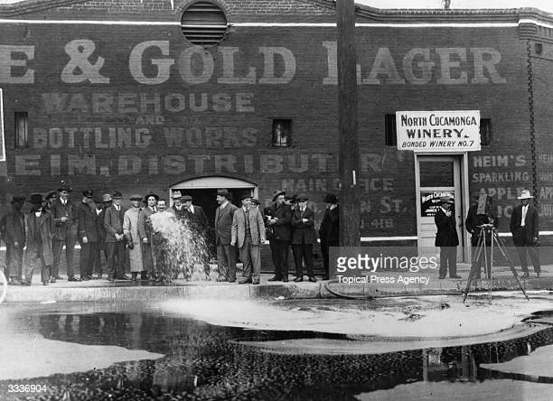 33100 gallons of wine being flushed into the gutter outside the North Cucamonga Winery in Los Angeles at the start of the National Prohibition on...