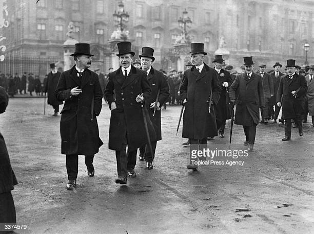 Members of London's City Guild walking away from Buckingham Palace after offering wedding gifts to Princess Mary