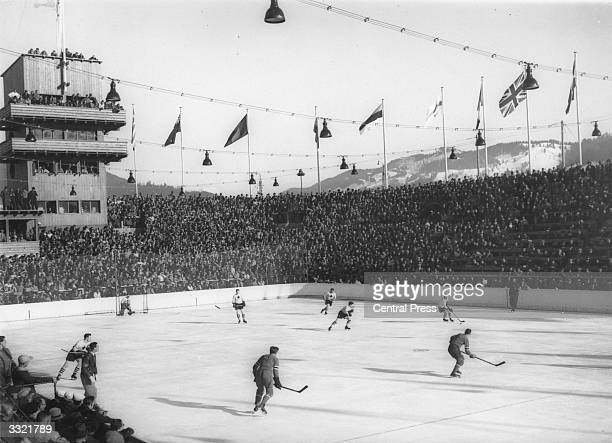 An ice hockey match between the USA and Canada during the Winter Olympics at GarmischPartenkirchen