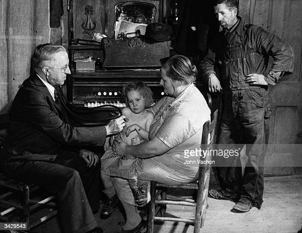 A country doctor examining a child in a farmhouse in Scott County Missouri