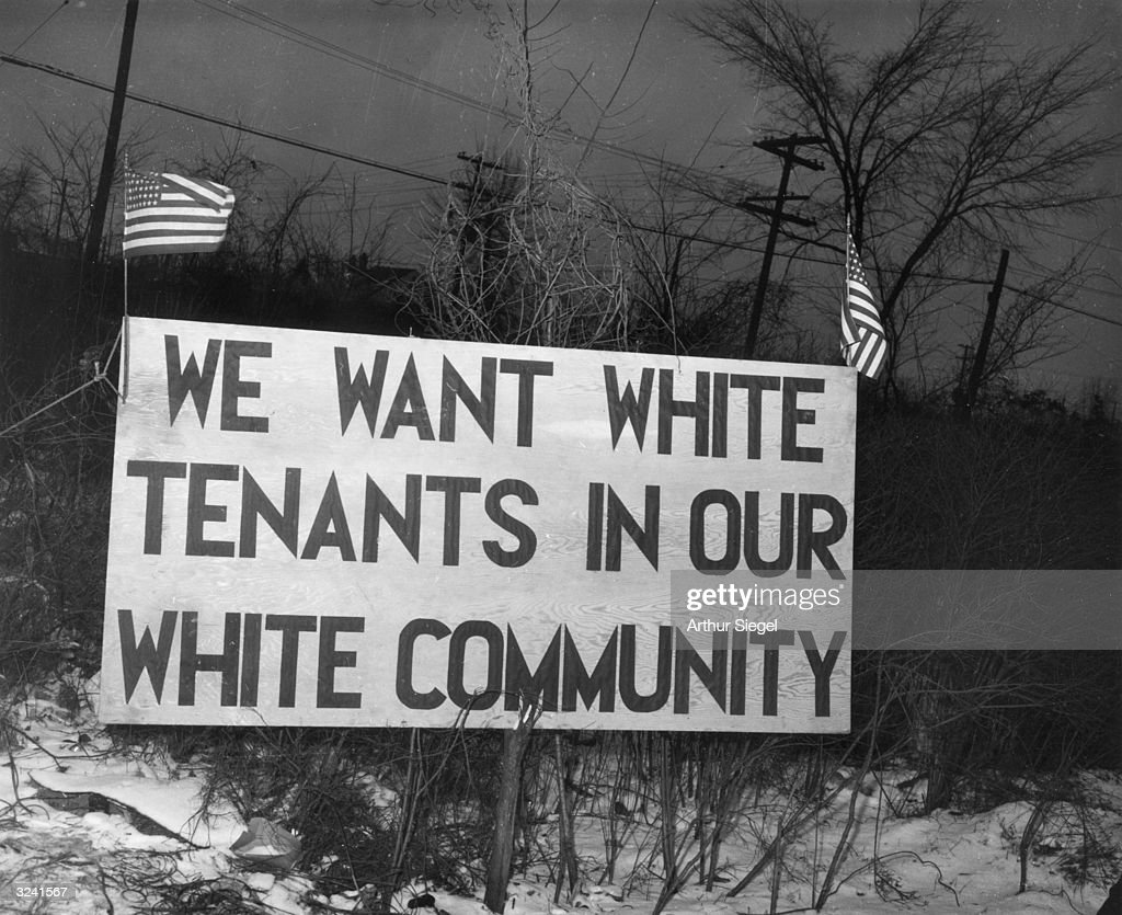 A sign placed across from the Sojourner Truth housing project reads ' We want white tenants in our white community' Detroit Michigan World War II