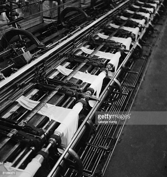 Utility nylon stockings being knitted on a production line at the Ballite Hosiery Mills St Albans