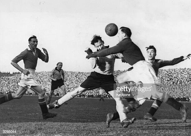 Footballers Crompton and Buchan in action during a match between Hull City and Manchester United