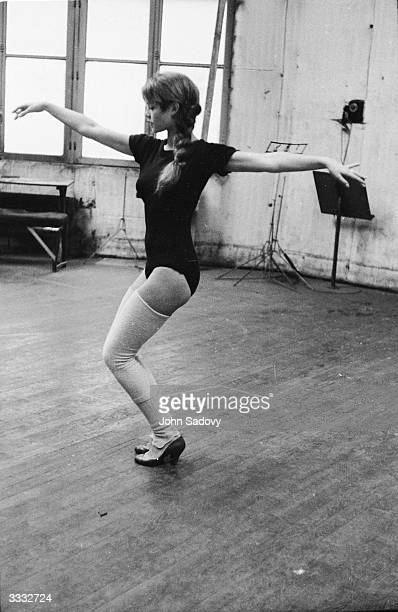 French actress Brigitte Bardot dancing in a rehearsal studio