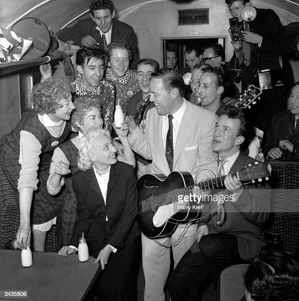Rock 'n' Roll King Bill Haley and his band The Comets entertain their fellowtravellers in a cramped railway carriage en route to London Behind them a...