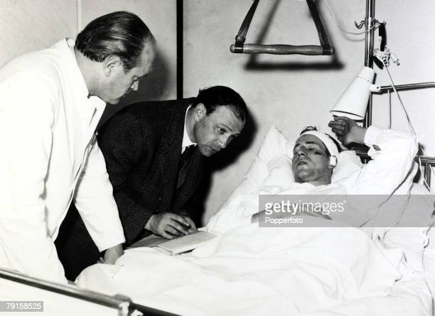 February 1958 Manchester United's Bobby Charlton is interviewed at the Isar hospital in Munich after being injured in the air crash which clamined...