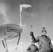 A skier uses a torch to light the Olympic flame atop snowcapped peak of Mount Olympus mythical home to the Greek gods prior to the commencement of...