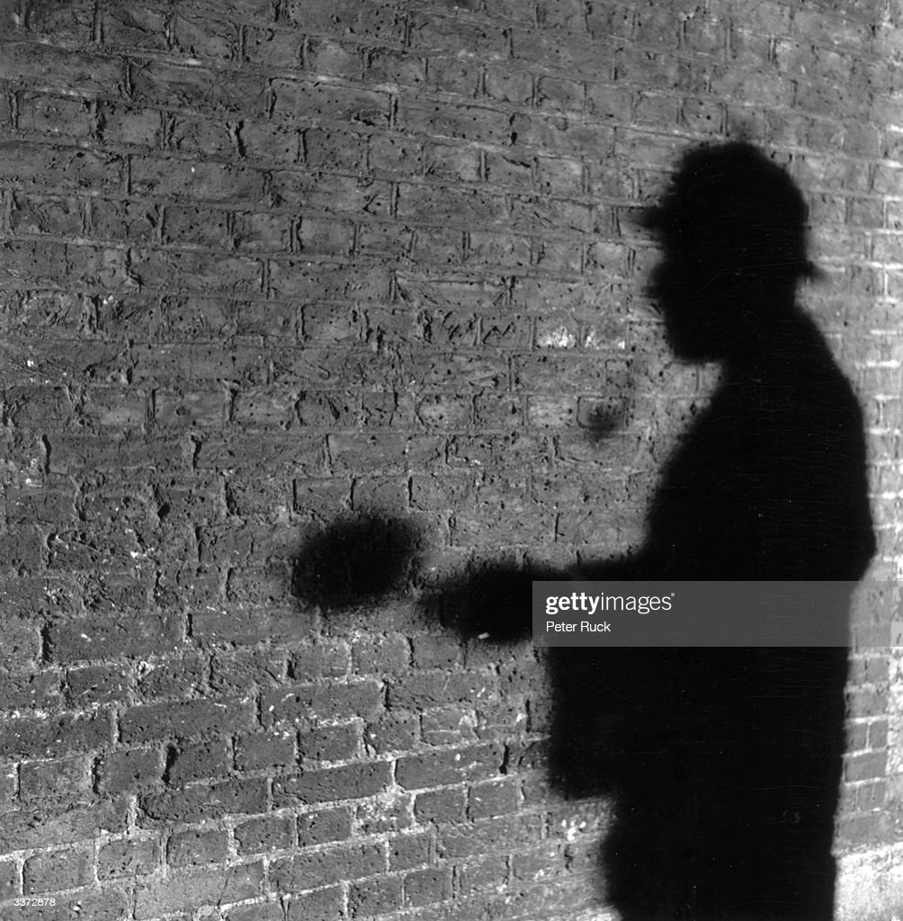 The shadow of R A Rendel, publicity manager for the Abbey National Building Society, in the guise of fictional detective Sherlock Holmes. Mr Rendel answers the fan mail sent to Holmes' address at 221b Baker Street, a site now occupied by the building society.