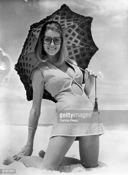Secretary Jan Souter shows off her midriff on a beach near Perth Australia