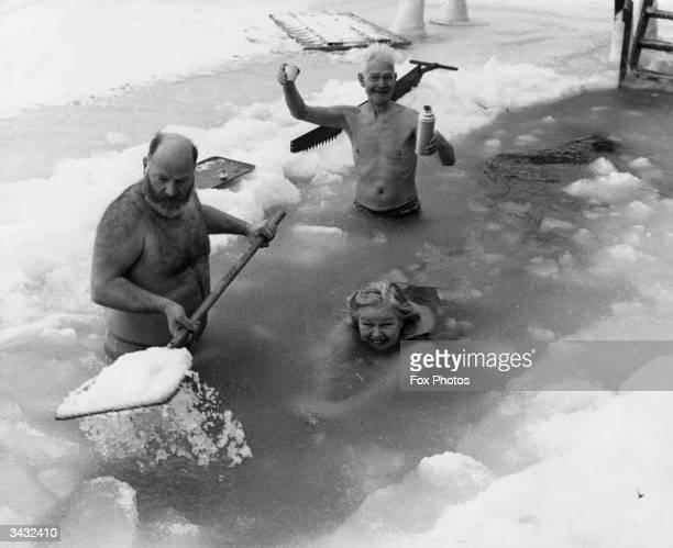 People swimming in a frozen lake in Scandinavia