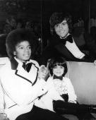 American singers Michael Jackson and Donny Osmond clasp hands while posing with child actor Ricky Segall at the American Music Awards Beverly Hills...