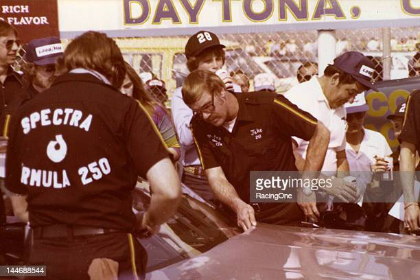 Crew Chief Jake Elder makes a check of the Harry Ranier Spectra Racing Oldsmobile driven by Buddy Baker during Speed Week activity at Daytona...